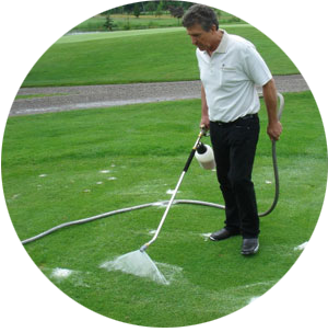 Spraying foam into the grass