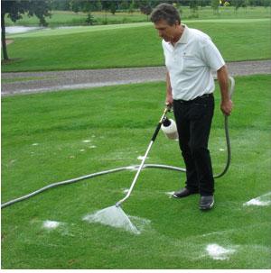 Spraying foam into the grass